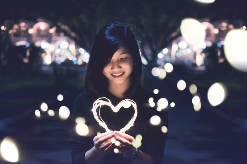 woman-holding-light-heart